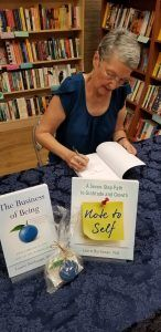 author Laurie Buchanan PhD signing books at Rediscovered Bookshop in Boise, Idaho