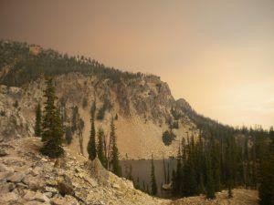 alpine lake near Stanley, Idaho; smoke and ash in sky create a surreal atmosphere