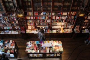 bookstore with floor to ceiling wood book cases and wood floors