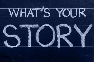 chalk board with writing: What's Your Story