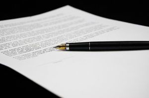 contract document and fountain pen