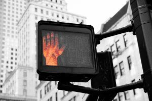 """cityscape walk signal on """"don't walk, red palm out"""" cycle"""