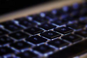 close-up of backlit laptop keyboard