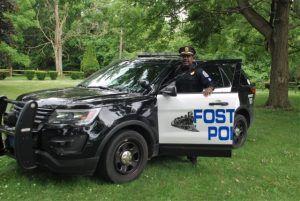 author Sgt. Clayton Moore (retired) with Fostoria, Ohio police cruiser