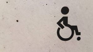 wheelchair access symbol on cement wall