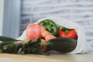fruits and vegetables in a reusable mesh shopping tote