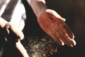 hand clapping with dust or chalk