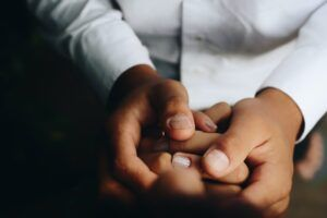closeup of two people holding hands