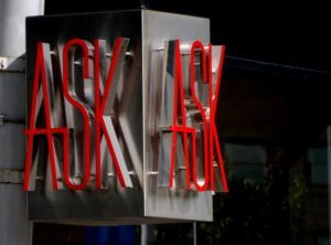 metal sign with red neon letters spelling ASK